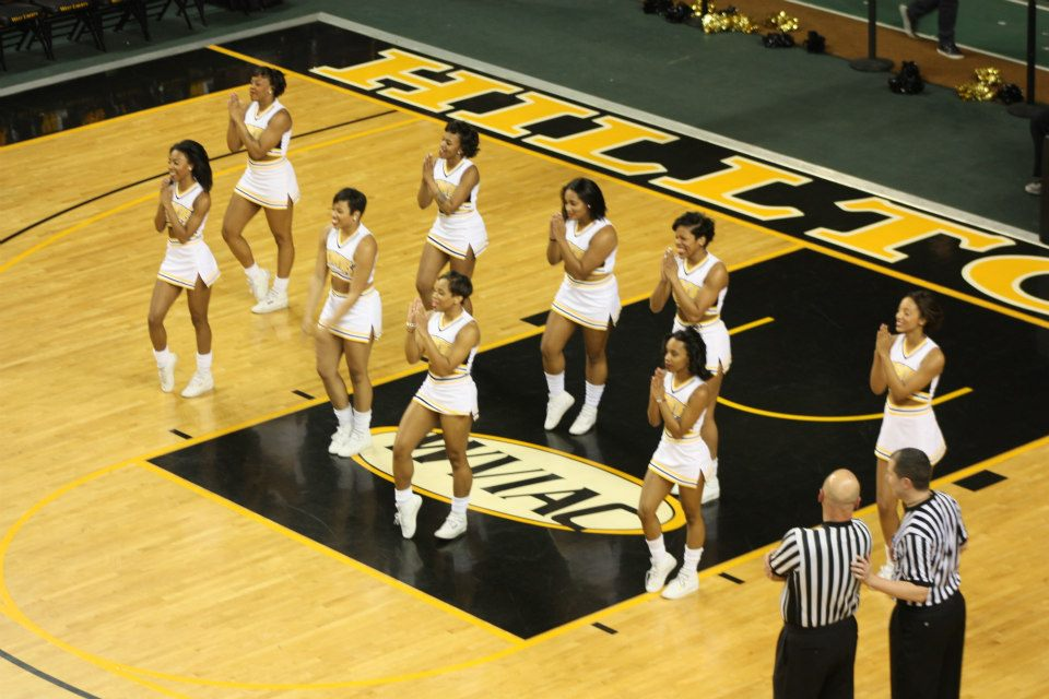"""Bowie State """"Golden Girls"""" cheer during a time out at the Quarterfinals NCAA Division II Atlantic Re"""