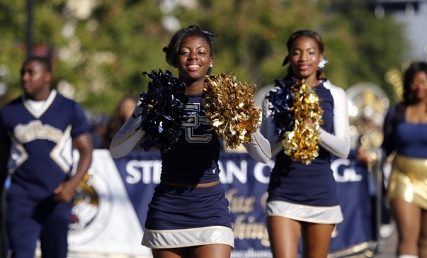 Still College Cheerleaders march in Homecoming Parade