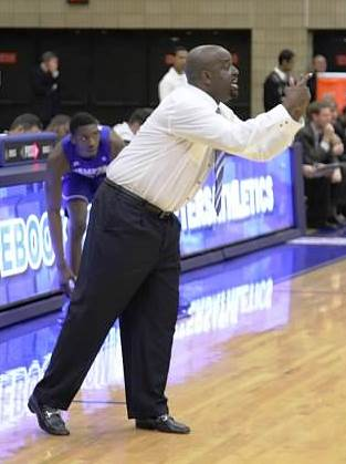 Hampton coach calls out to his team during the ga...