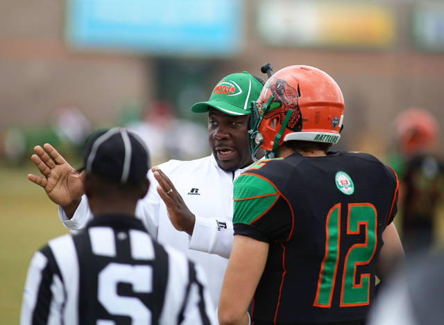 Florida A&M head coach Earl Holmes talks with qua...
