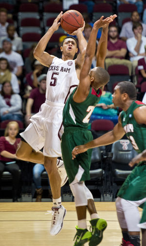 Mississippi Valley State looks to block a shot by...