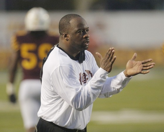 Bethune-Cookman head football coach looks on as t...