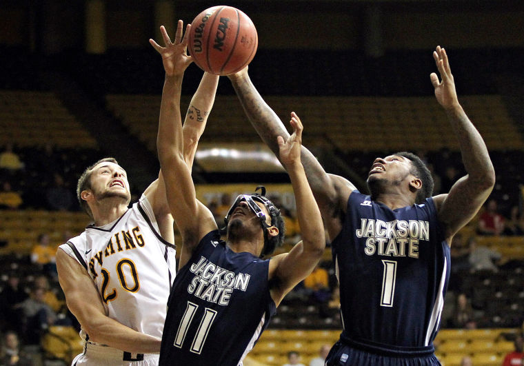 Jackson State and Wyoming battle for a rebound