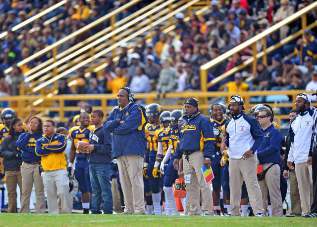 North Carolina A&T head coach and team looks as t...