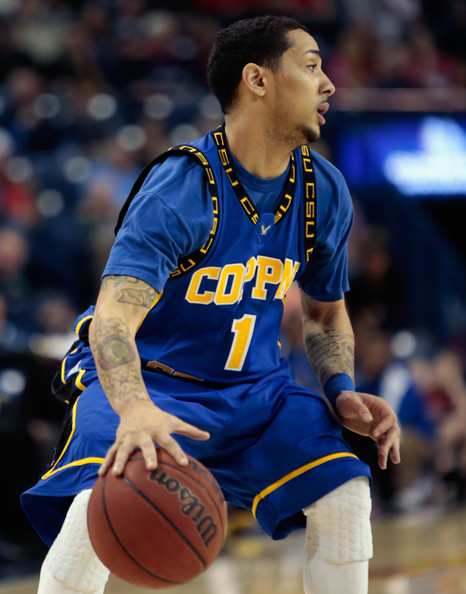 Coppin State Eagles player controls the ball agai...