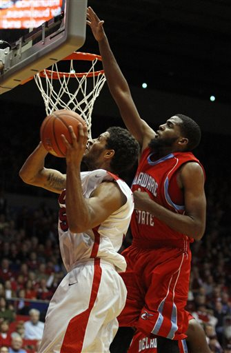 Delaware State Hornets looks to block a shot agai...