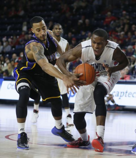 Coppin State and University of Richmond players b...
