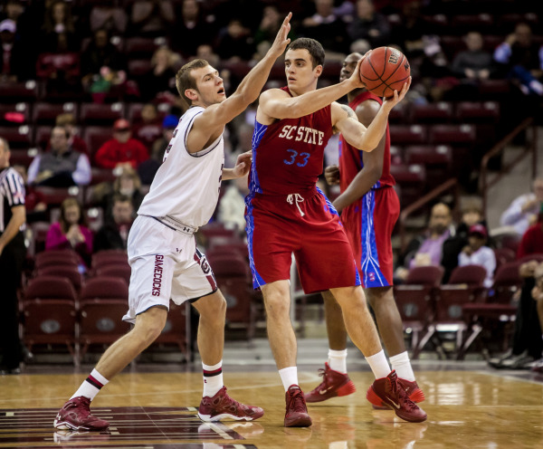 South Carolina State Bulldogs is defended by Sout...