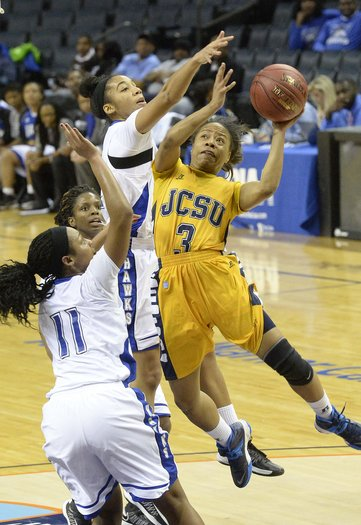 Johnson C. Smith Lady Golden Bulls carries the ba...
