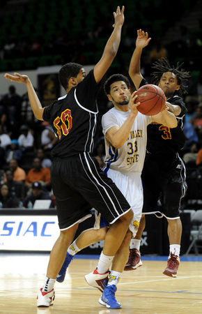 Fort Valley State shoots between Tuskegee players...