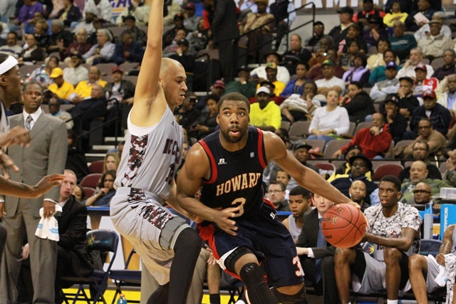 Howard University Bison drives to the basket agai...