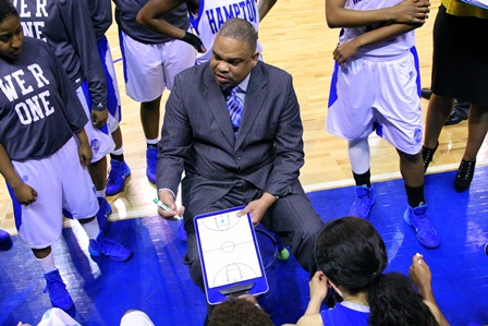 Hampton University coach talks to his team during...