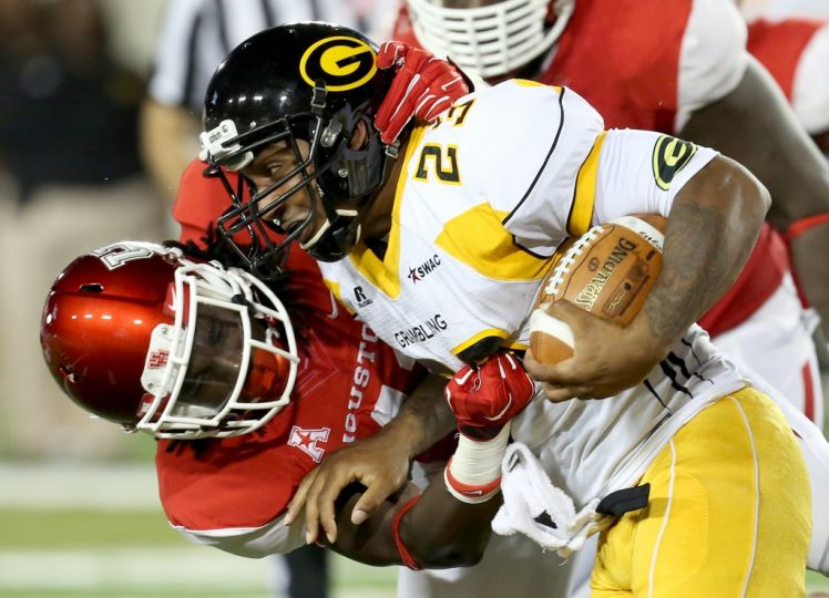 Grambling State Tigers running back is tackled by...