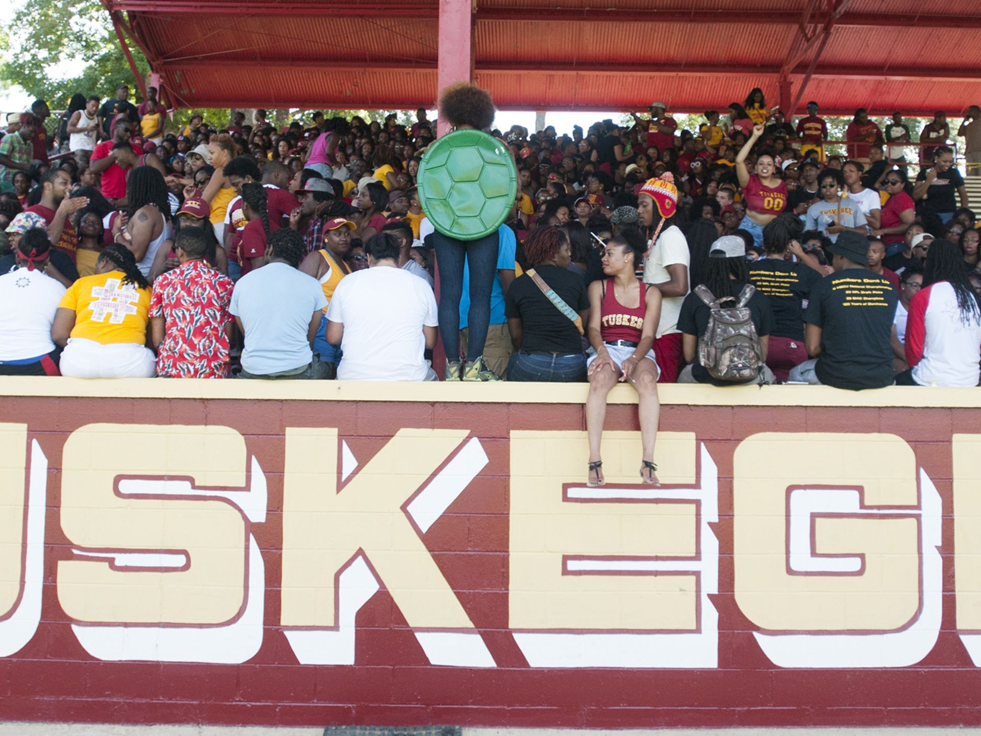 Tuskegee students begin to fill the student secti...