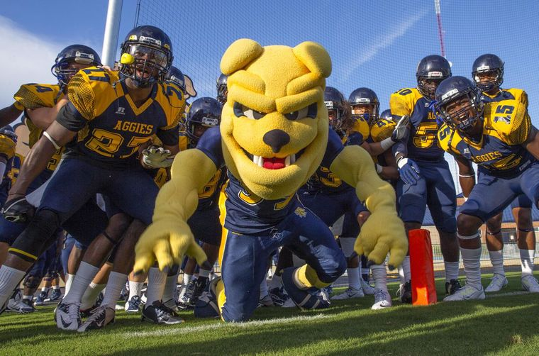 North Carolina A&T players join the mascot as the...