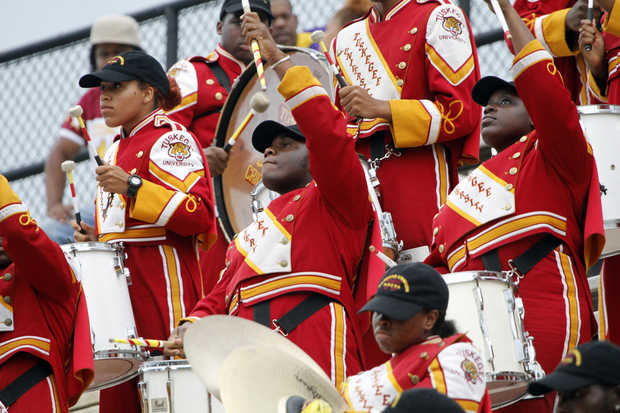 Tuskegee University marching band plays in the st...
