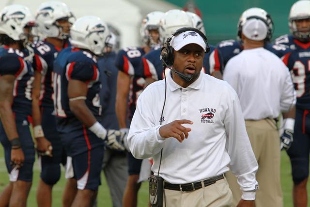 Howard University head football coach looks on as...