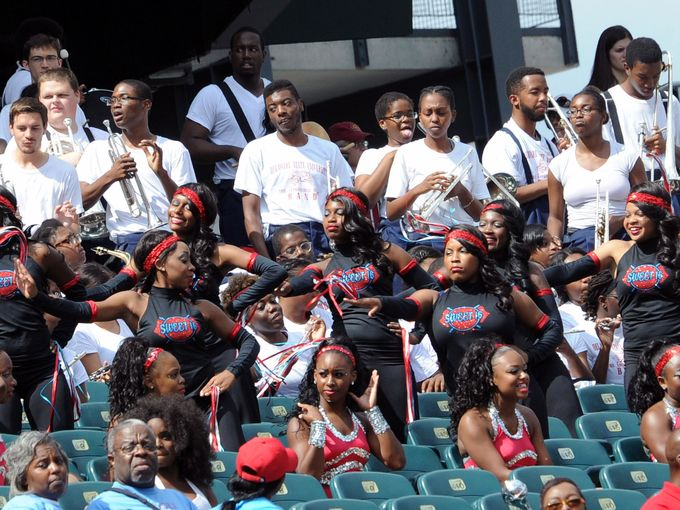 Delaware State dancers and marching band entertai...