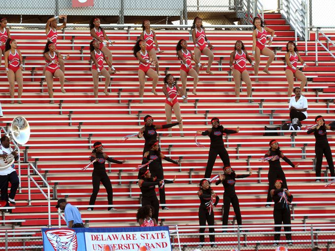 Delaware State dancers perform in the stands duri...