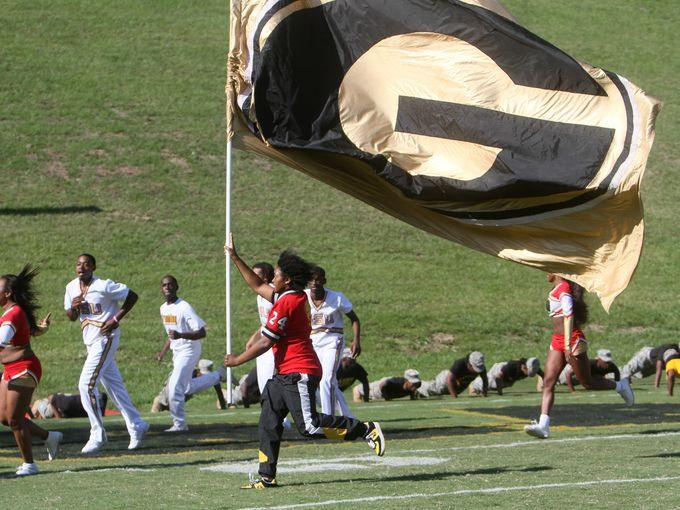 Grambling State cheerleaders lead the Tigers on t...