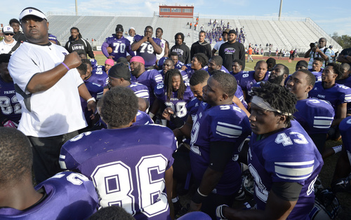 Paine Head Coach Greg Ruffin meets with his team ...