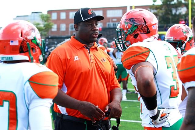 Florida A&M head coach Earl Holmes talks to his p...