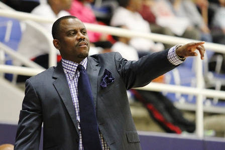 Howard Bison basketball coach looks on as his tea...