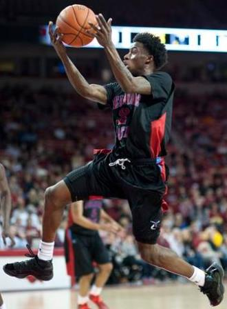 Delaware State leaps to the basket in the first h...