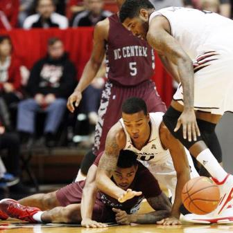 North Carolina Central goes for a loose ball agai...