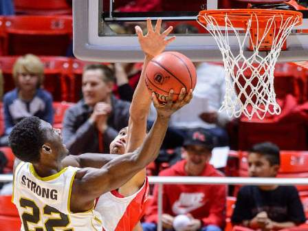 Alabama State Hornets shoot the ball, defended by...