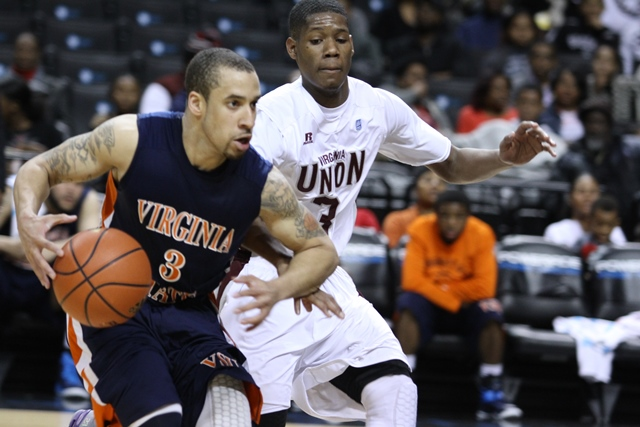 Virginia State Trojans drive to the basket agains...
