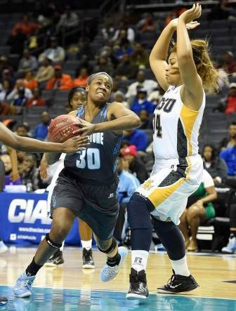 Livingstone Lady Blue Bears drive the ball to the...