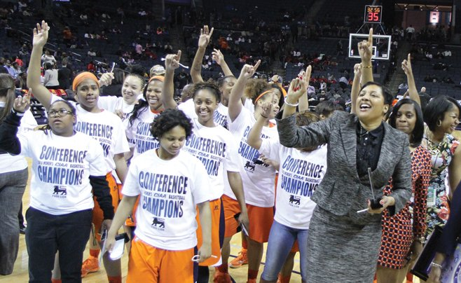 Virginia State Lady Trojans celebrate victory ove...