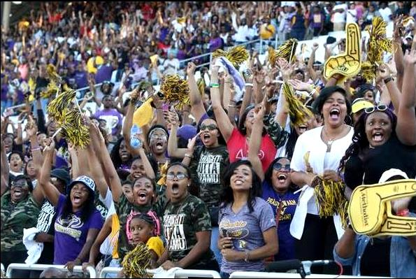 Prairie View A&M fans react to a touchdown by the...