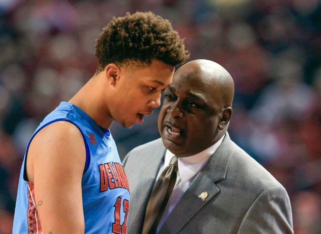 Delaware State coach Keith Walker talks to Joseph...