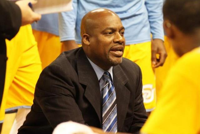 Southern basketball coach Roman Banks talks to te...