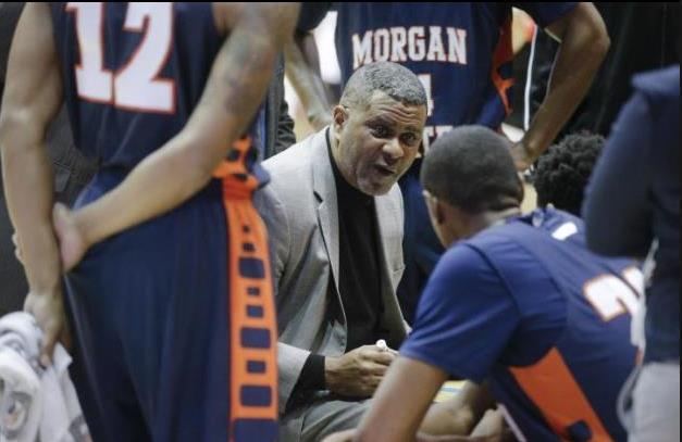 Morgan State head coach Kevin Boseman talks to hi...