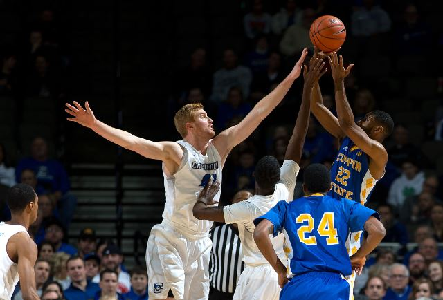 Coppin State and Creighton battle for the ball