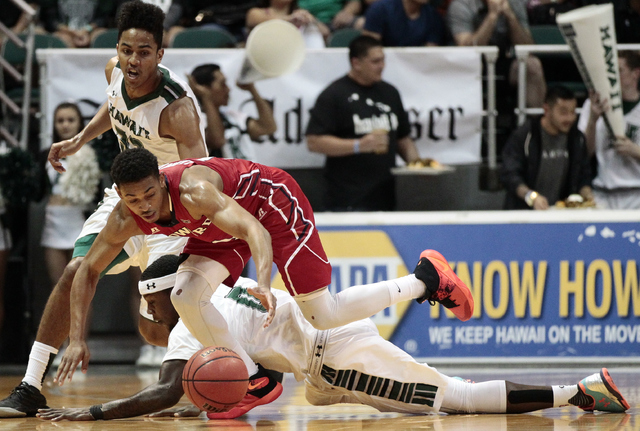 Howard and Hawaii battle for the basketball