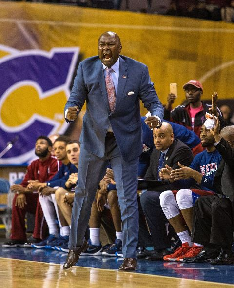 South Carolina State basketball coach looks on fr...